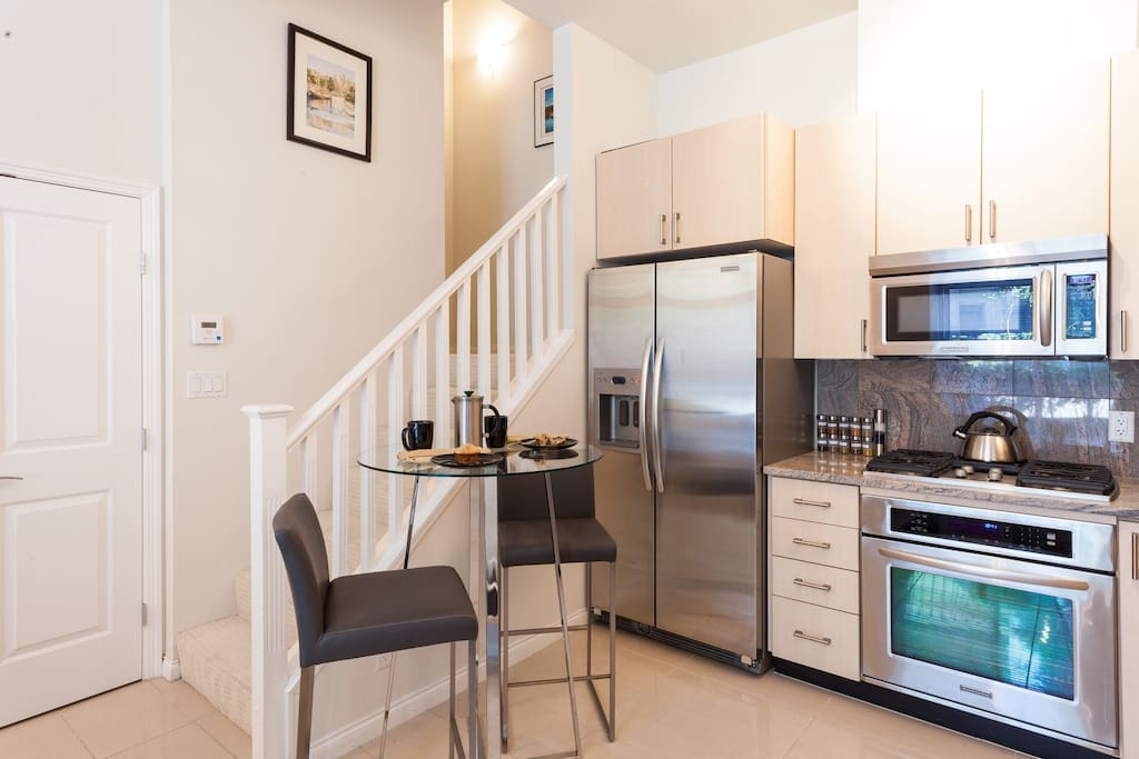 Kitchen features gas elements, stainless steel appliances and granite counter tops.