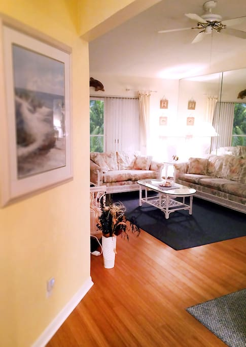 A lovely view of the living area with its beautiful bamboo hardwood floors!