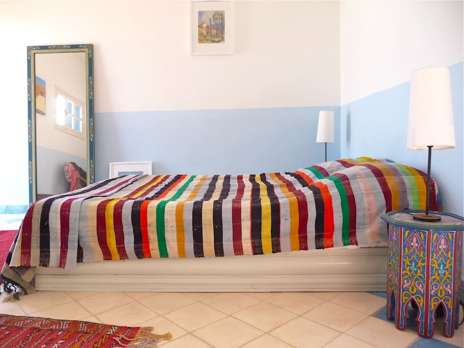 The Blue Room - colourful main double bedroom on lower terrace