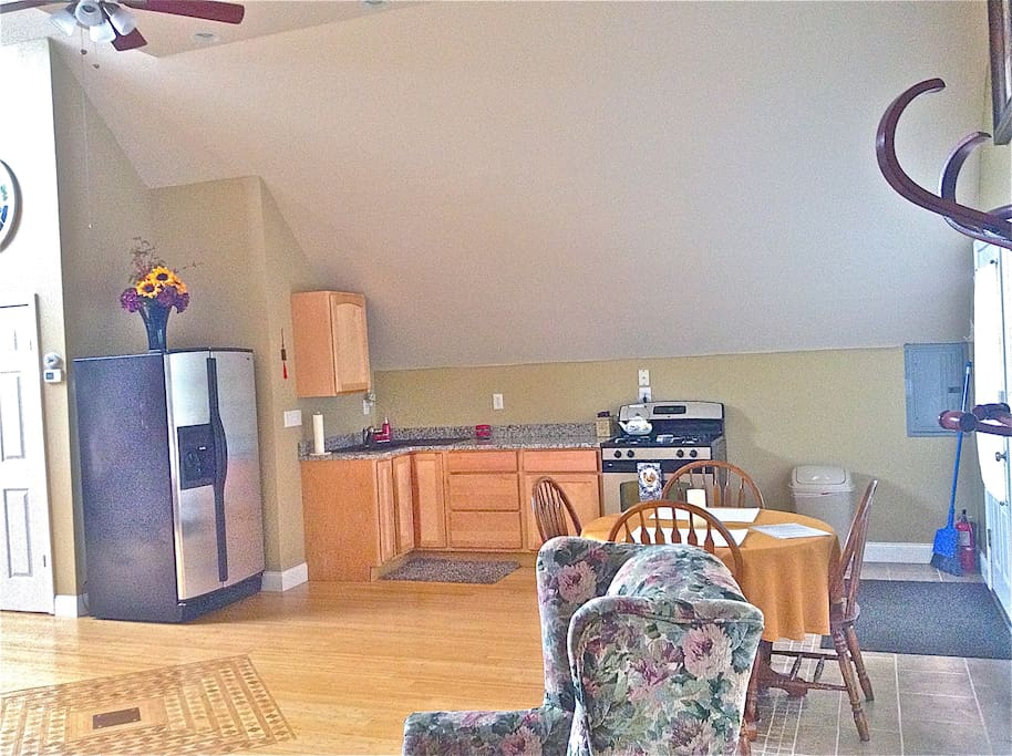 Full Kitchen with all utensils, toaster, coffee maker, and cookware you need.
