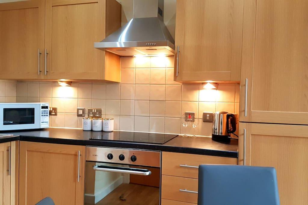 Modern kitchen space with utensils