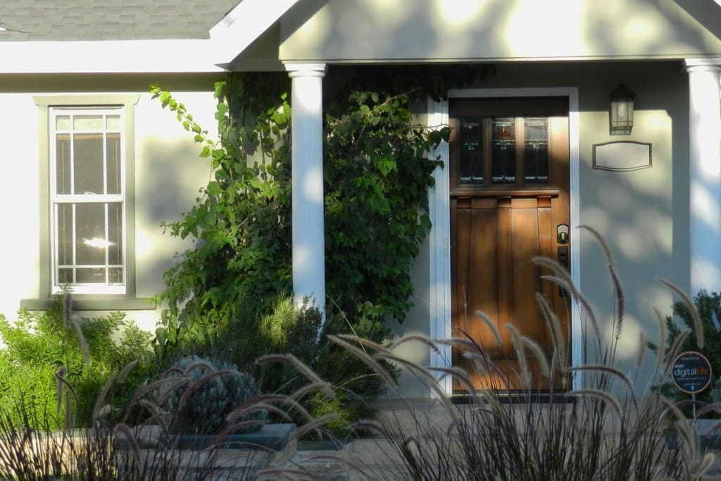 """Waving cattails and a handsome wood door greet you. """"Even better than the pictures!"""""""