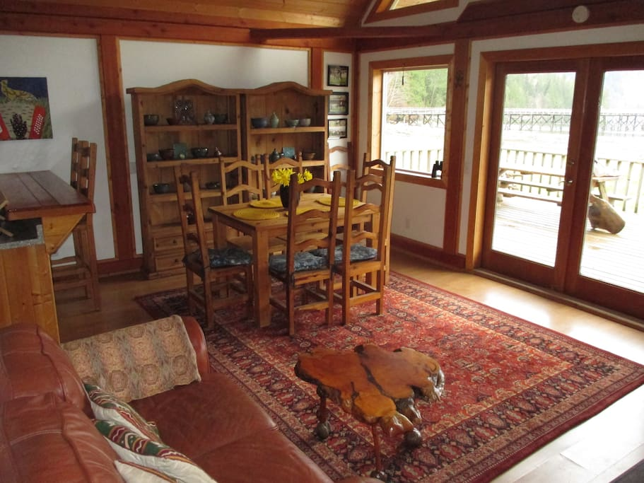 Front room boasts breathtaking mountainscape views of the bay, and includes a piano, potbelly stove, full kitchen, and porch.