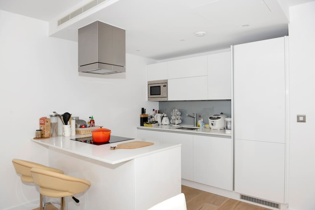 The kitchen is fully equipped with a wine fridge, dishwasher, oven, hob, fridge and microwave