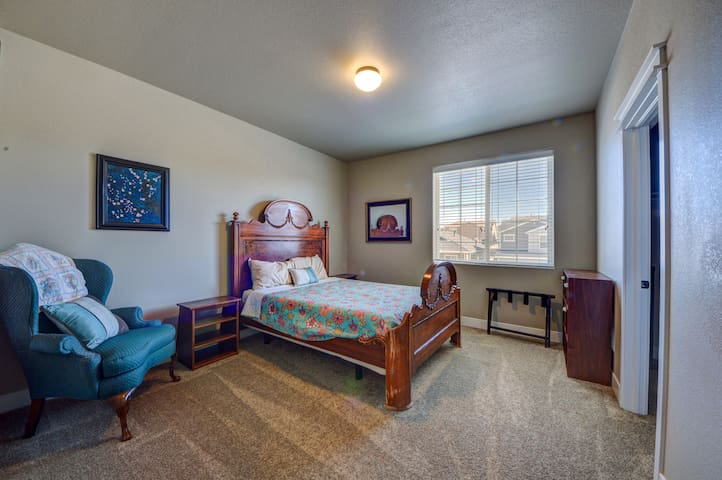 The first guest bedroom has a cozy queen mattress, and plenty of space.