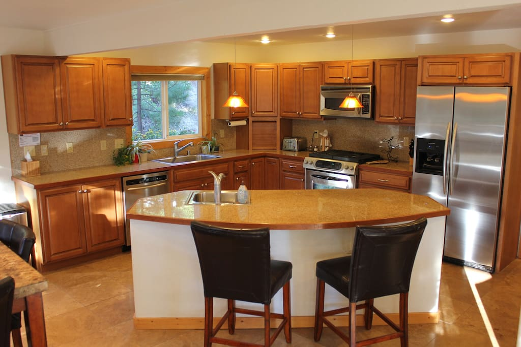 Updated kitchen with granite counters, stainless steel appliances and 2 sinks!