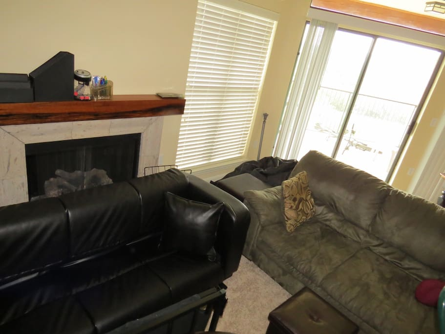 Rental's living room, couch and 2 person futon