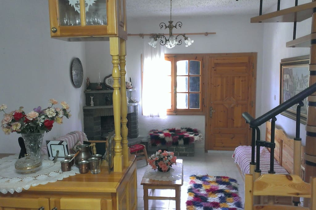 Main living room with traditional decoration and fireplace ready for use!