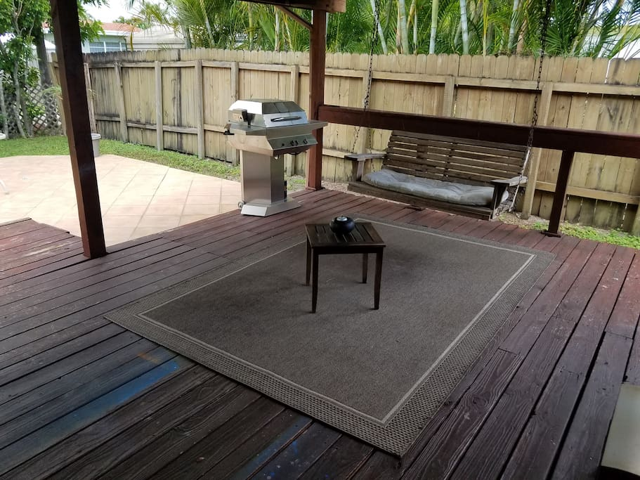 Grill and chill backyard with swing