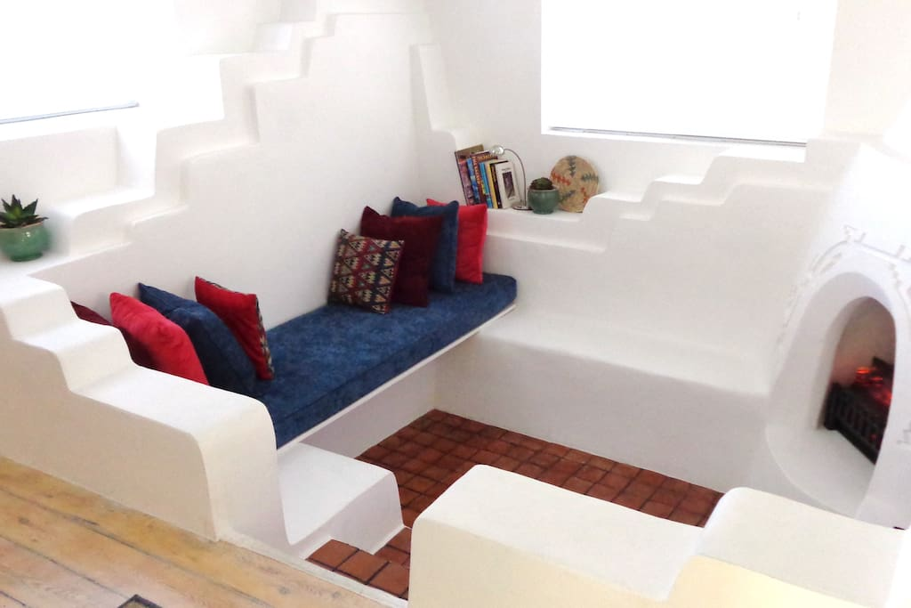 The sitting area within the sunken living room, fireplace on right.