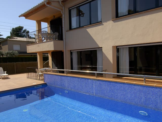 Renovated apartment with community swimming pool