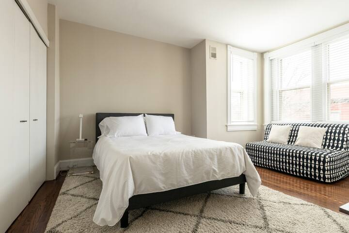 Master bedroom with cozy seating
