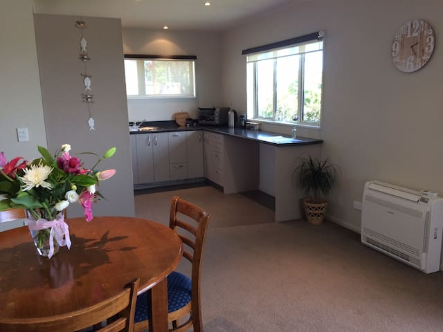 Kitchen and dining area with heatpump.