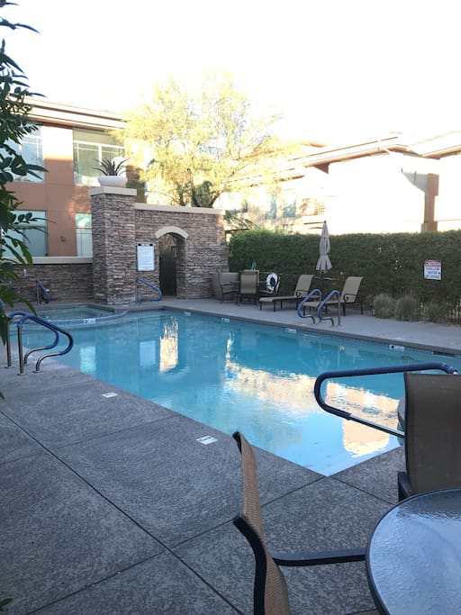 Community Pool and heated hot tub with BBQ Grills