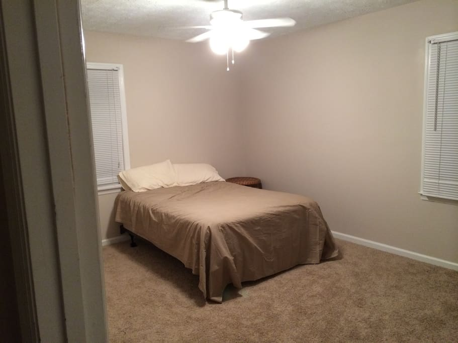 Bedroom with full size bed and ceiling fan