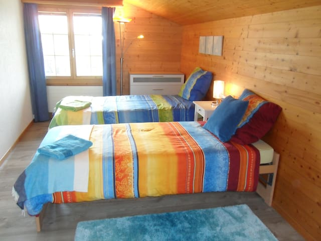 The Sunset room on the upper Level has two single beds and can accommodate up to two guests.