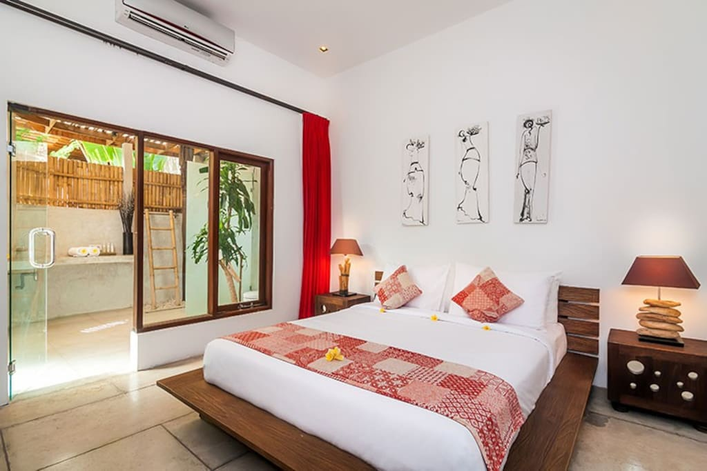 1st Air 1st air-conditioned bedroom features queen-size bed and en-suite bathroom.