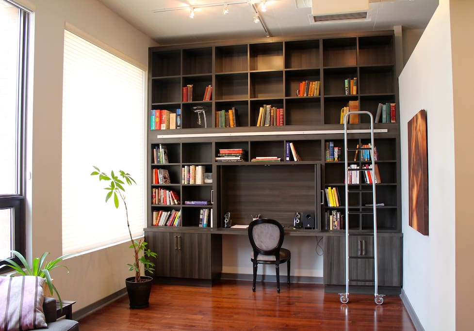 Bookworms take note: a floor-to-ceiling library with sliding ladder.