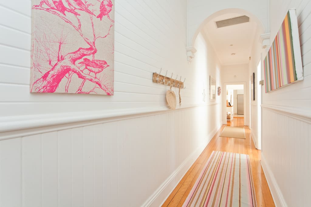 Sun filled hallway, beachy feel with wooden floorboards