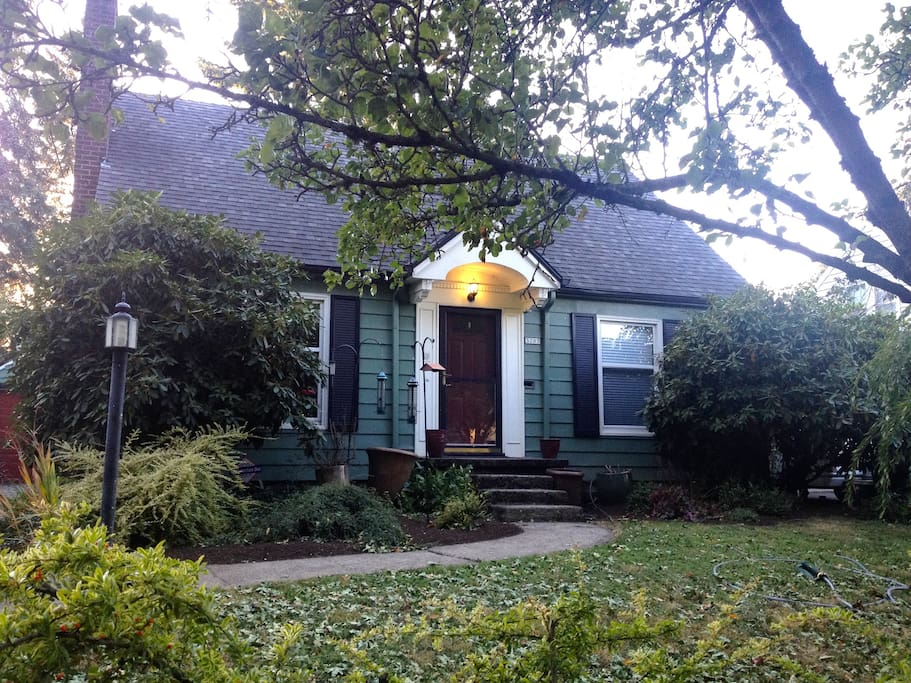 1940's Cape Cod on a large lot with gardens.