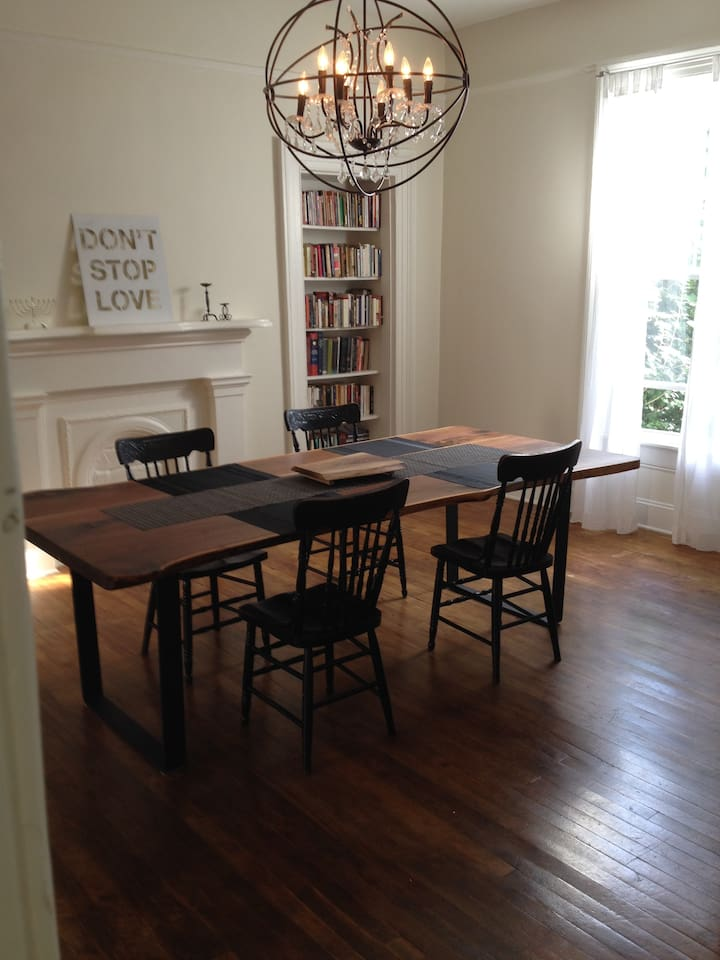 Spacious dining room with large live-edge harvest dining table