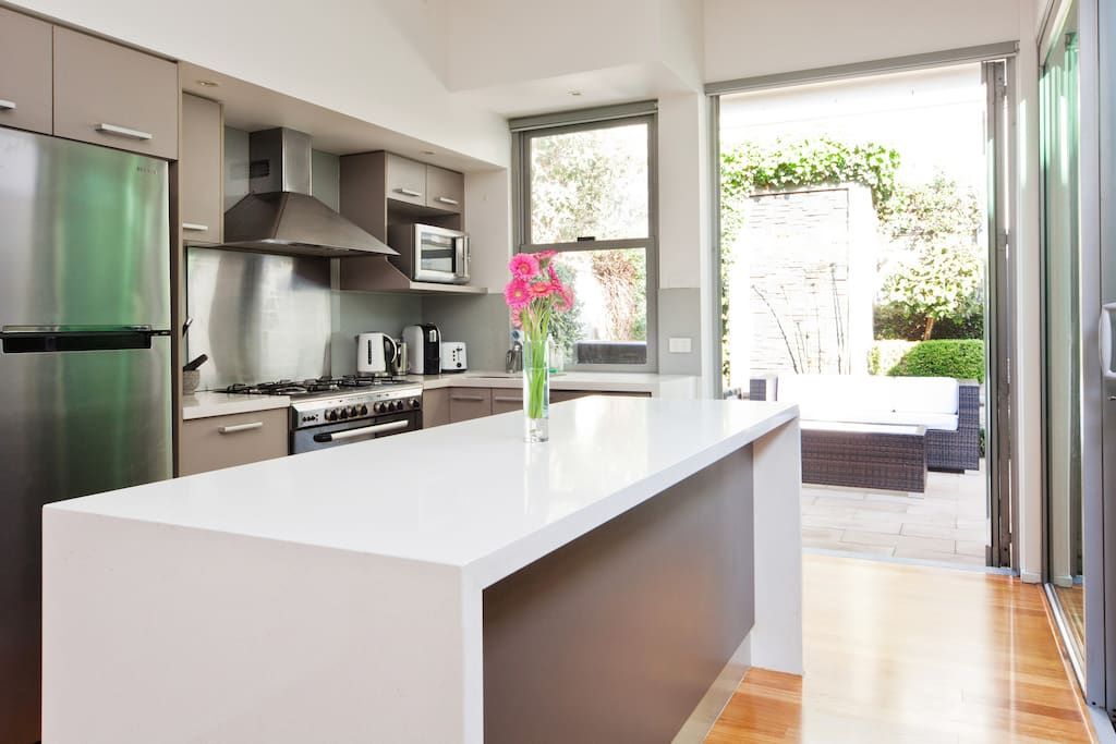 An open kitchen with chef's oven, gas cooktop and dishwasher of course - who wants to wash dishes on holidays?  We have lots of cooking appliances for whatever it is that you wish to cook up during your stay.