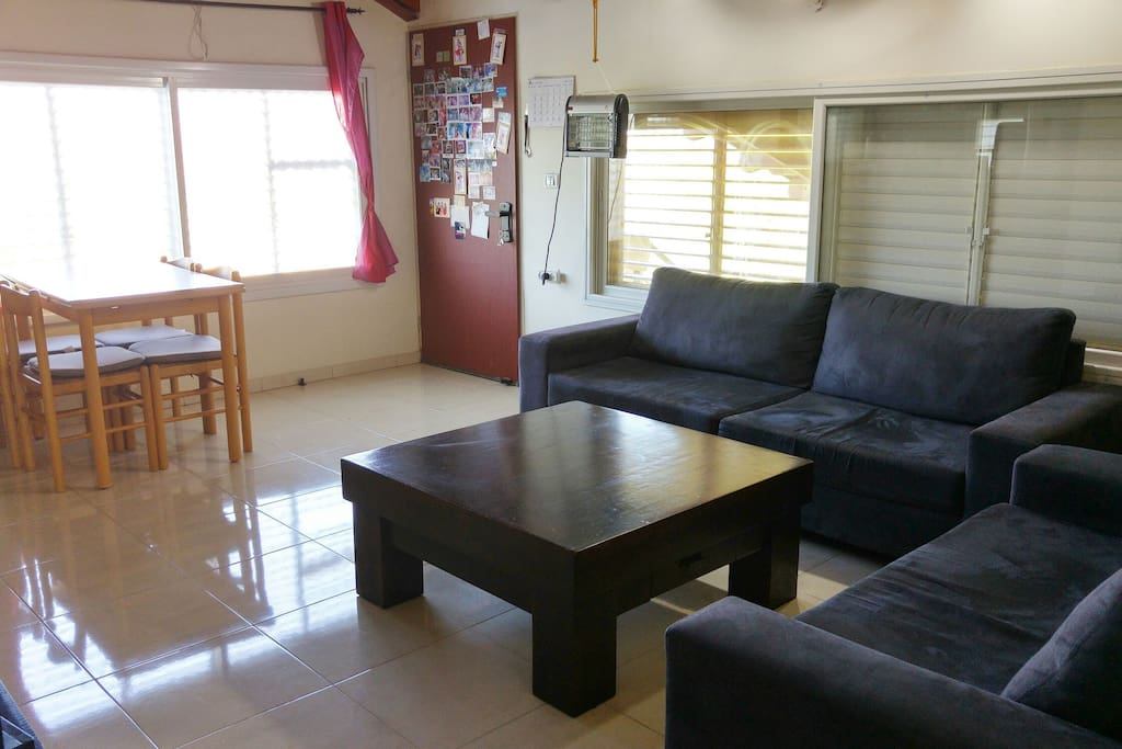 Spacious living room with dining room table