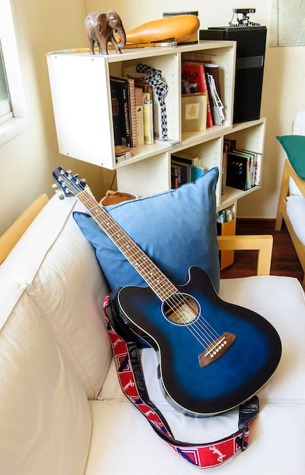 spacious living room, sea breezed(!) wood floor, sound system, guitars, library...