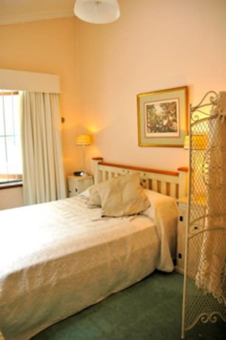 Your bright and airy bedroom. The sun streams in - morning and afternoon.