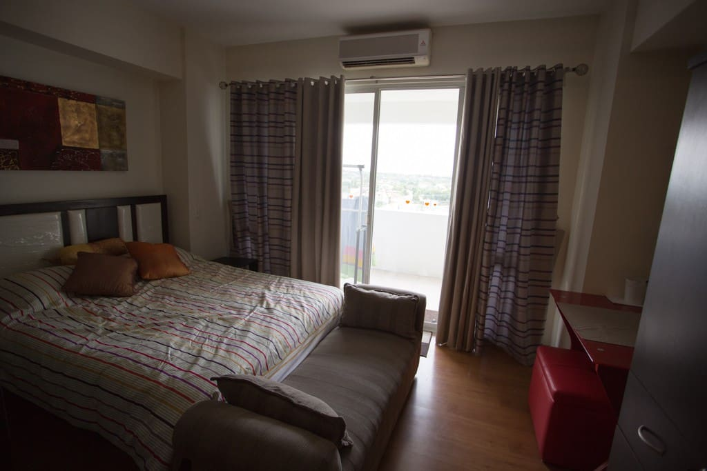 queen size bed and balcony facing Alabang Village and Alabang Town Centre