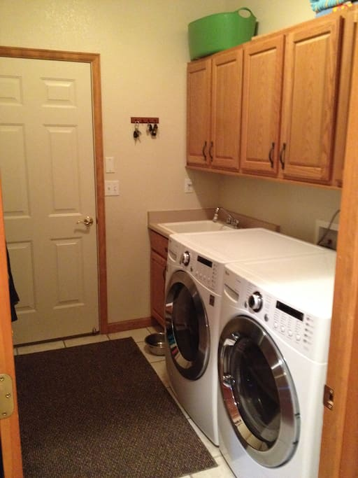 Laundry room off of the garage with utility sink
