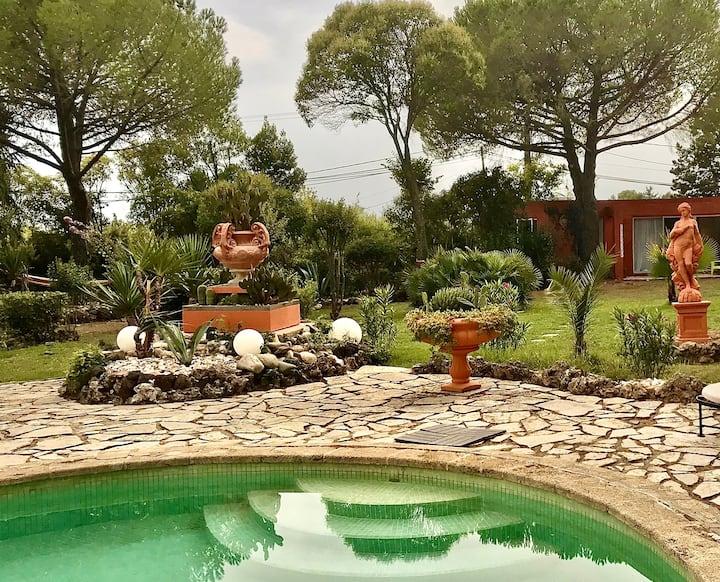 Appartement privé situé dans un jardin magnifique