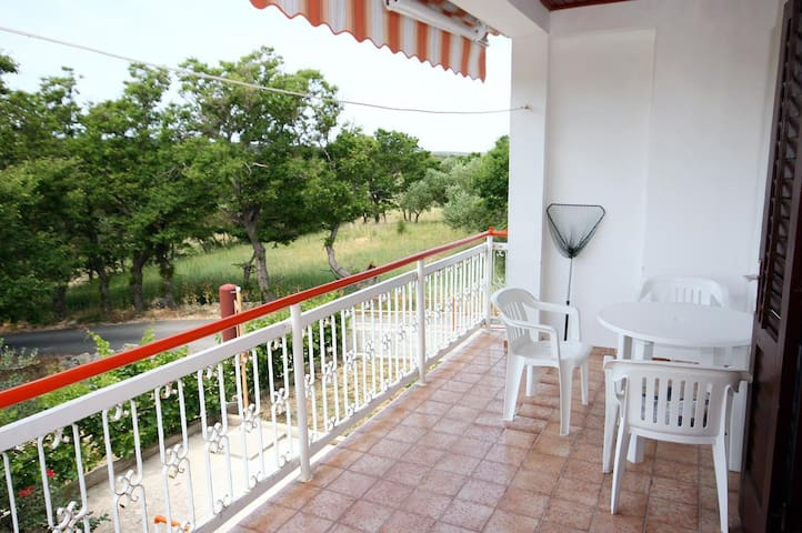 Two bedroom apartment with terrace and sea view Caska (Pag) (A-202-b)