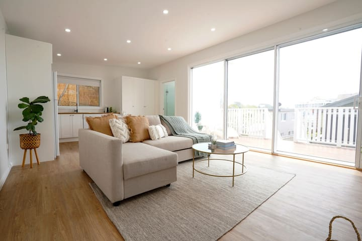 Open plan living space. Includes a fold out sofa that turns into a double bed.