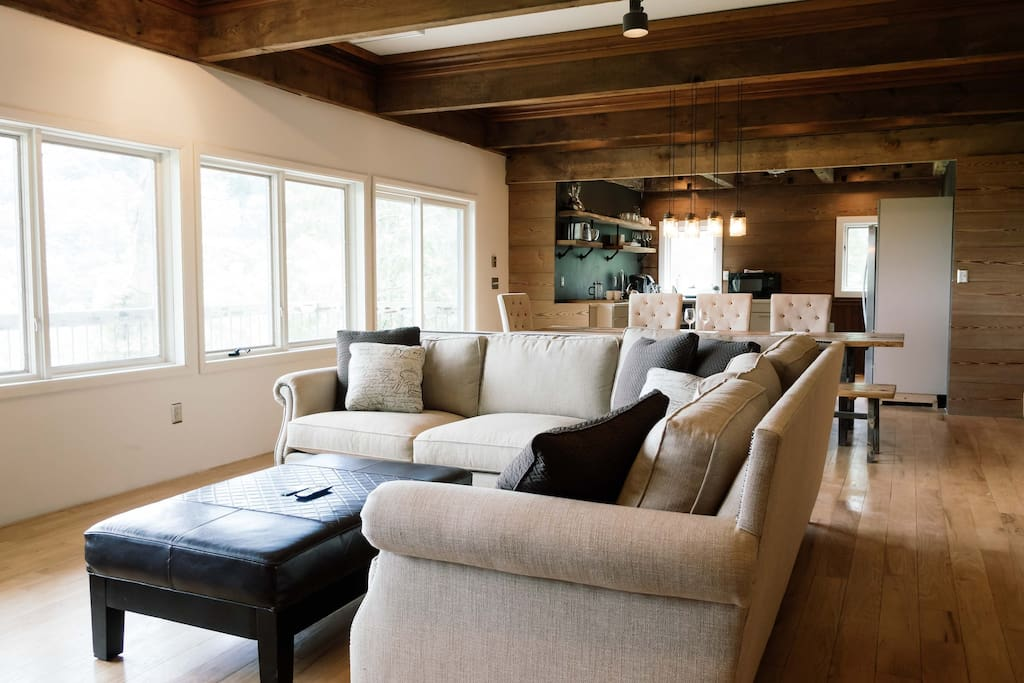 Relax in the spacious living room while enjoying mountain views.