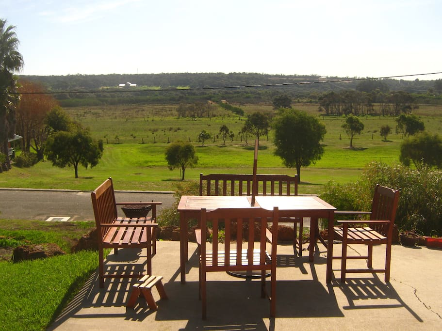 Sit outside, North facing, BBQ with view and relax.