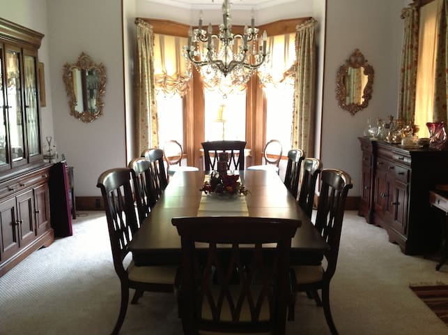 Gracious formal dining room seats 8-10.