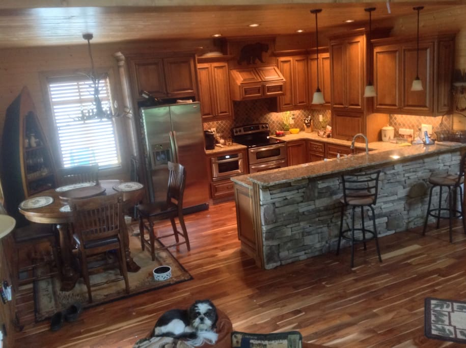 Kitchen, breakfast bar, and dining area