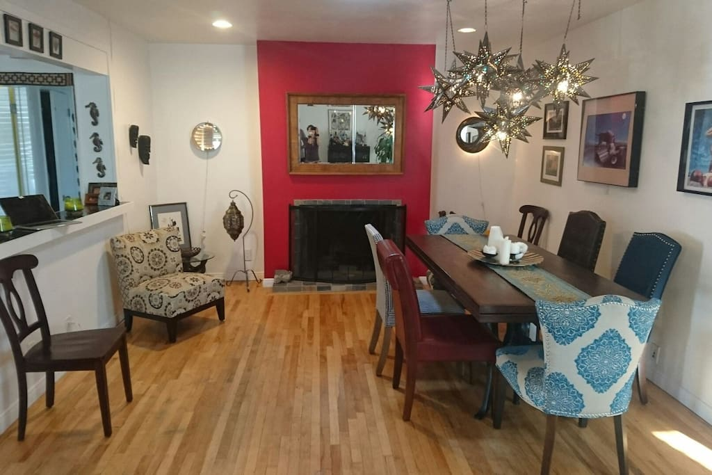 Full dining room with fireplace can seat up to 8