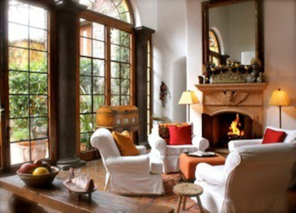 Four armchairs around the fireplace...perfect place to chat or have a glass of wine.