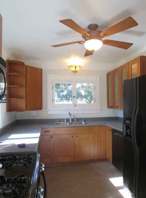 sunny kitchen, there are blinds now and newer appliances