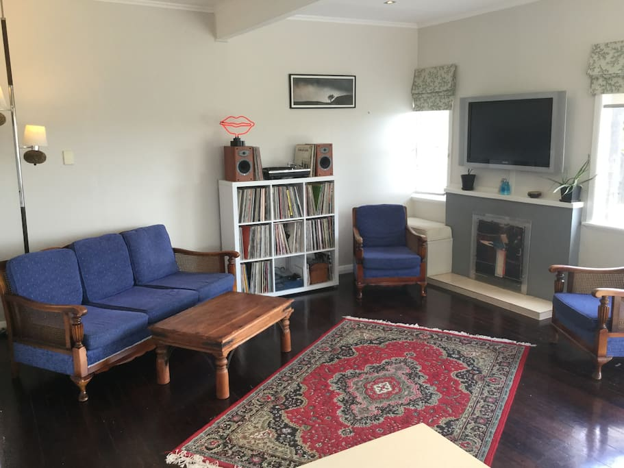 A wide shot of the living room from the kitchen bar.