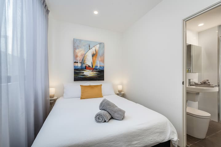 Queen size bed with fresh linen for every stay. Sheer curtain and block out blinds.