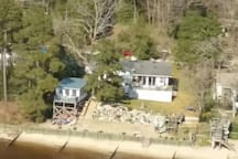 An areal shot of our home and of the bungalow sitting just back from the water.