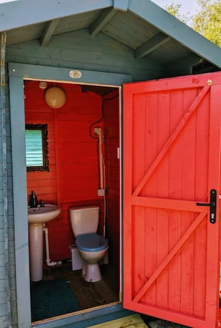 Our shower is outdoors, together with a colourful full size working toilet and sink in it's own cabin.