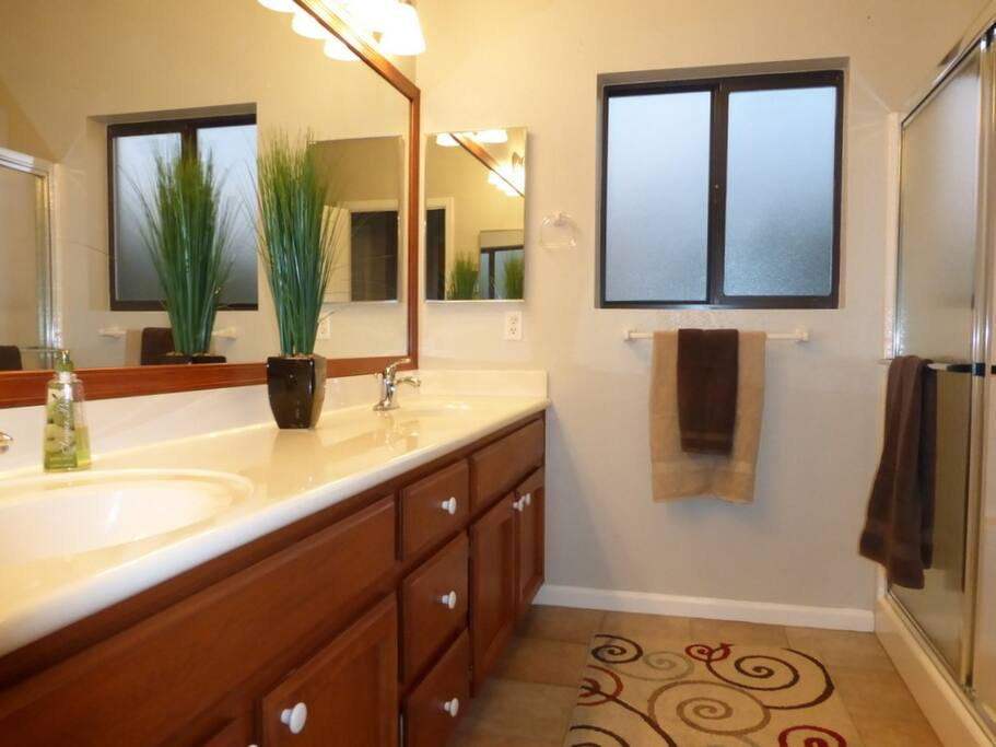Guest bathroom with double sinks and walk in shower