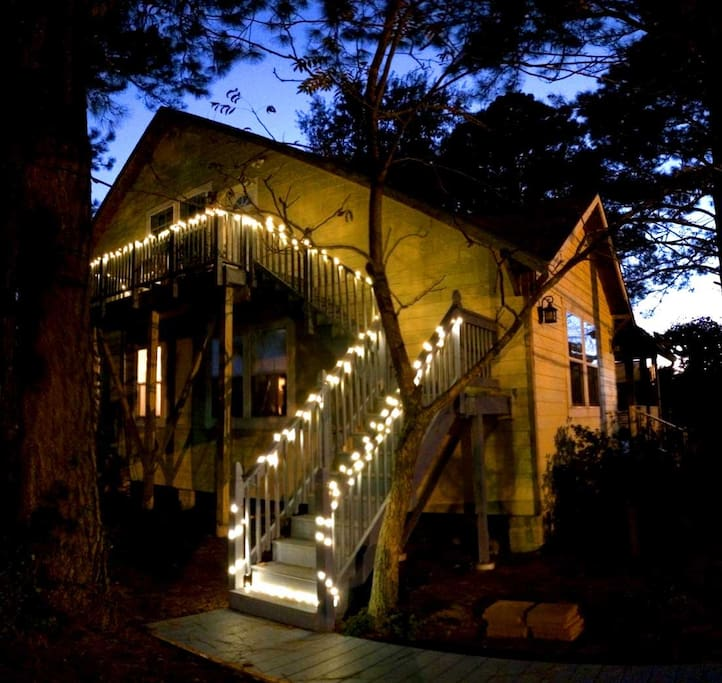 House balcony entrance well-lit by charming lights