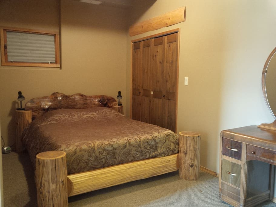 Comfortable log bed with 400 thread count sheets and a feather duvet.