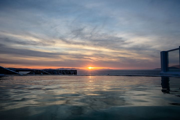 Mykonos Art Villas pool & sea with sunset 1