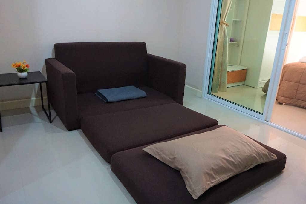 Sofa bed for extra person with additional pillow and blanket